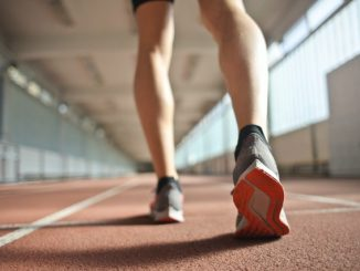 fit runner standing on racetrack in athletics arena 3756165