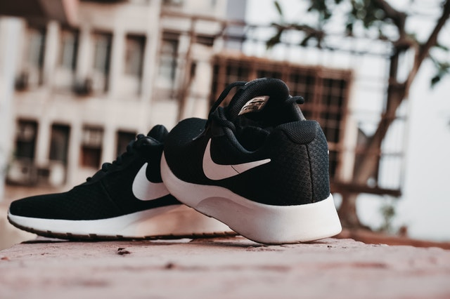 macro photography of pair of black and white nike running 1124466